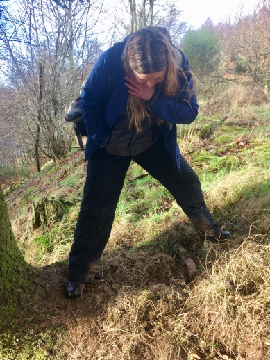 Project Officer Elaine Rainey inspecting a badger nest